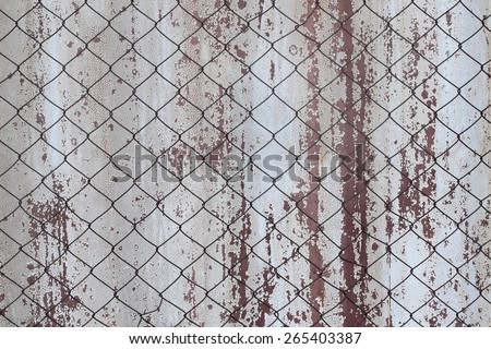 iron net cage side old wall in zoo - stock photo
