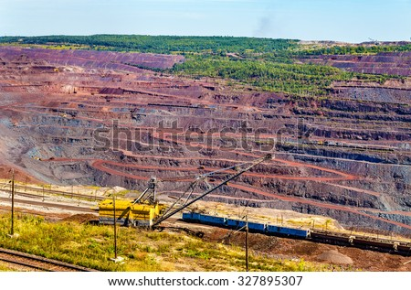 Iron ore mining in Mikhailovsky field within Kursk Magnetic Anomaly, Russia - stock photo