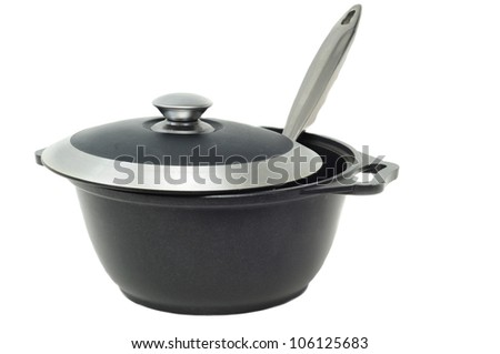 iron pan with a lid and spoon - stock photo