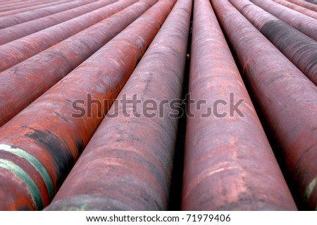iron pipes, in an area of petroleum drilling - stock photo