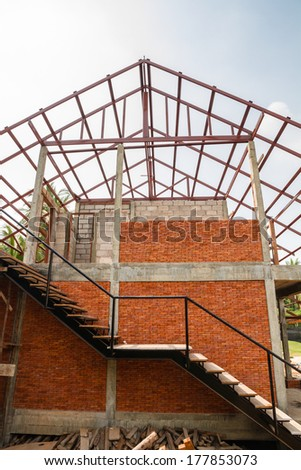 Iron structure and brick wall of new house - stock photo