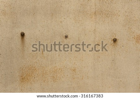 Iron wall with old paint with streaks of rust and rusty screws. textural composition - stock photo