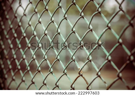 iron wire fence DOF, process color - stock photo