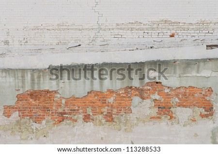 Irregular brick and stucco wall grunge background - stock photo