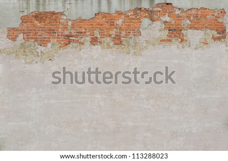 Irregular brick and stucco wall grunge texture - stock photo