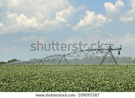 Irrigation equipment watering a crop of soybeans - stock photo