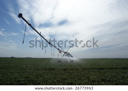 Irrigation of a soybean field in Argentina - stock photo