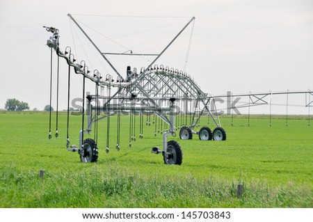 Irrigation sprinklers in a field, Canada - stock photo