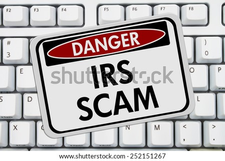 IRS Scam Danger Sign,  A red and white sign with the words IRS Scam on a keyboard - stock photo