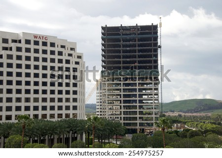 IRVINE, CA - FEBRUARY 22, 2015: Construction continues on the Park Design Plan for 766 unit apartment complex at the north west corner of Irvine Center Drive and Alton adjacent to the WATG Building. - stock photo