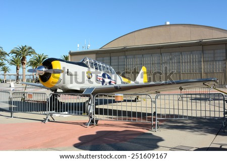 IRVINE, CA - FEBRUARY 10, 2015: Plane and Hangar at the Orange County Great Park. An SNJ-5 Texan WWII era plane on display at the Great Park in Irvine, California.  - stock photo
