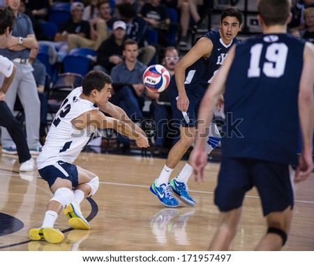 IRVINE, CA - JANUARY 17: Brigham Young University's Jalen Reyes gets the dig in a volleyball match with the University of California - Irvine at the Bren Center in Irvine, CA on January 17, 2014 - stock photo