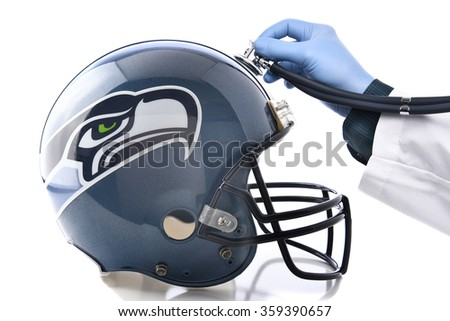 IRVINE, CA - JANUARY 6, 2015: Seattle Seahawks Football Helmet with Stethoscope. Sports Concussion concept, an ongoing problem in the NFL. - stock photo