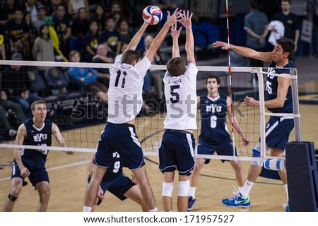 IRVINE, CA - JANUARY 17: The Brigham Young University men's volleyball team competes with the University of California - Irvine at the Bren Events Center in Irvine, CA on January 17, 2014 - stock photo