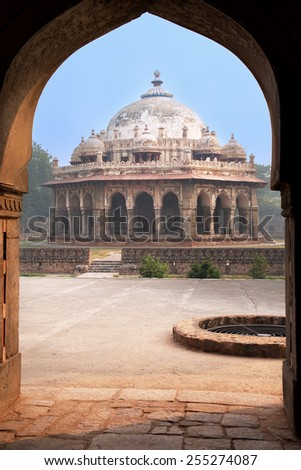 Isa Khan Niyazi tomb seen through arch, Humayun's Tomb complex, Delhi, India. It was the first garden-tomb on the Indian subcontinent. - stock photo