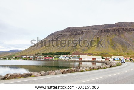 ISAFJORDUR, ICELAND - SEPTEMBER 11:  A view of the Isafjordur waterfront in Northern Iceland on September 11, 2015. - stock photo