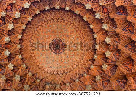 Isfahan, Iran - December 13, 2015: Beautiful ceiling of the Qeysarieh Portal, main entrance to market (Bazaar) in Isfahan, Iran. - stock photo