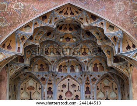 ISFAHAN, IRAN - OCTOBER 23: Plaster-work of music hall of Ali Qapu palace on October 23, 2014 in Isfahan. Ali Qapu was built by decree of Shah Abbas I in the early seventeenth century. - stock photo