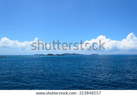 island and sea with blue sky - stock photo