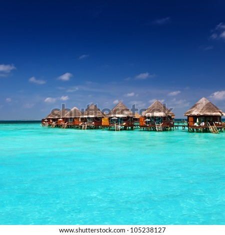 Island in ocean, Maldives.Villa on piles on water - stock photo