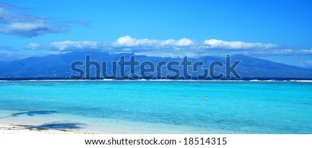 Island of Tahiti viewed from island of Moorea - stock photo