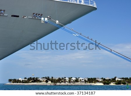 Island Under The Bow Of A Moored Cruise Ship - stock photo
