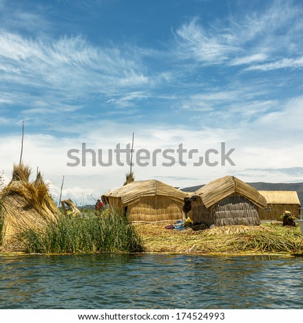 Island Uros. Titicaca (Titiqaqa) is a lake in the Andes on the border of Peru and Bolivia - stock photo
