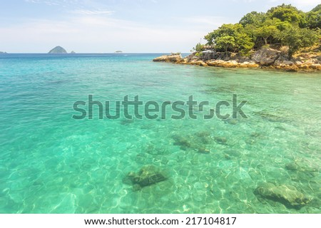 Island with clean and clear water - stock photo