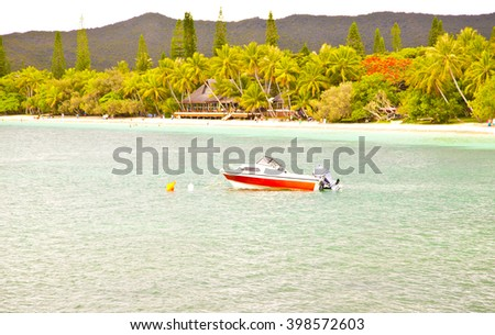isle of pines,life on beach,vacation,holiday,people on the beach,green water,holiday beach,boat on beach,trees near beach ,isle beach,island,dream island,isle of pines,new caledonia ,wonderful island  - stock photo