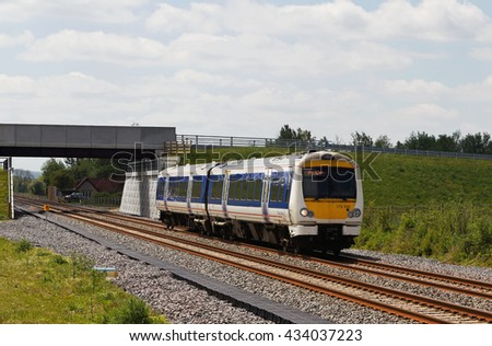 ISLIP, UK - MAY 16: A Chiltern Railways suburban commuter train heads toward London departing from Oxford on May 16, 2016 in Isllip.  Chiltern operate a fleet of 87 units over 336Km or rail. - stock photo