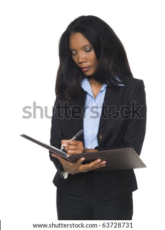 Isloated studio shot of an African American woman writing on her notepad. - stock photo
