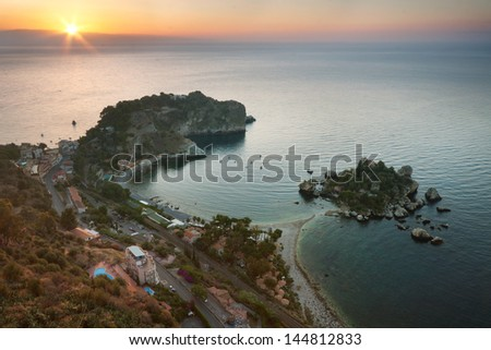 Isola bella at sunrise in Taormina, Sicily - stock photo