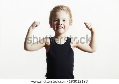 Isolate Child. Funny Little Boy.Sport Handsome Boy. Strong. bodybuilder. showing his hand biceps muscles - stock photo