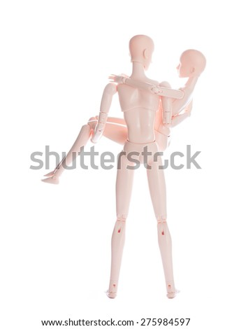Isolate Couple Doll Man Carrying Woman - stock photo