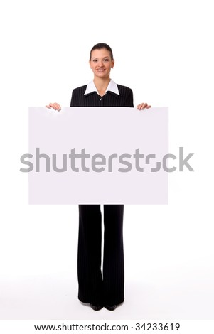 Isolate of a business woman standing beside a blank board - stock photo