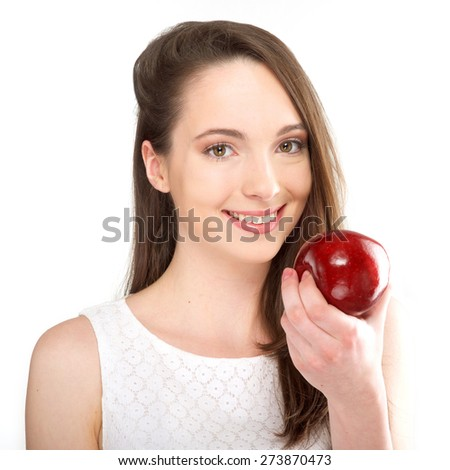 isolated a beautiful girl with apple on white background - stock photo