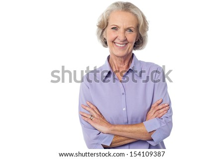 Isolated aged lady posing with crossed arms - stock photo