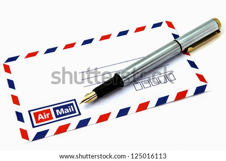 isolated air mail envelope with pen - stock photo
