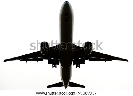 Isolated airplane seen from below - stock photo