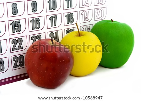Isolated apples a close up on a background of a calendar - stock photo