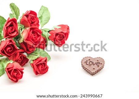 Isolated artificial red roses with love letter, symbol of love, valentines and celebration on white background - stock photo