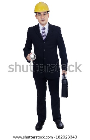 Isolated asian engineer carrying blueprints and suitcase - stock photo
