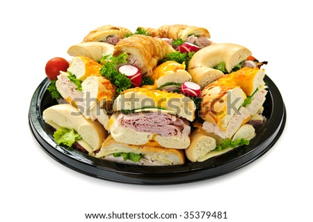 Isolated assorted platter of sandwiches with meat and vegetables - stock photo