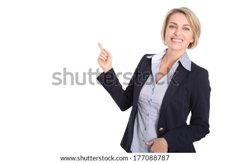 Isolated attractive blond woman pointing with index-finger on white background.  - stock photo