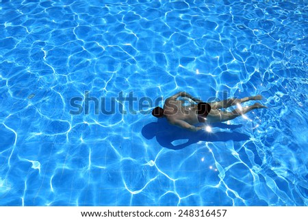isolated azure water pool and swimmer in the water  - stock photo