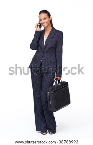 Isolated beautiful businesswoman on phone going to work - stock photo