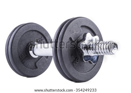 isolated big chrome metal dumbell with disks - stock photo