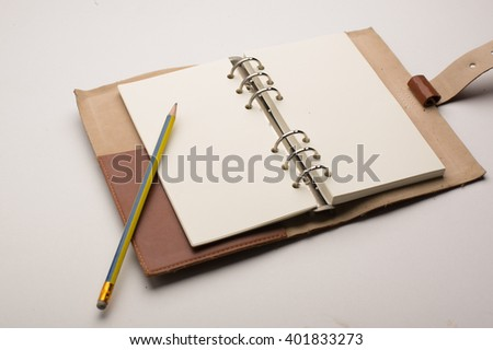 isolated blank notebook with pencil on white backgrounds, business concept - stock photo