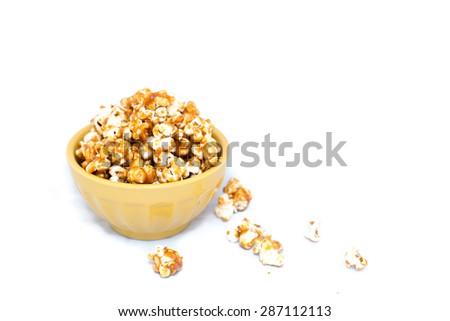 Isolated bowl of caramel popcorn on white background - stock photo