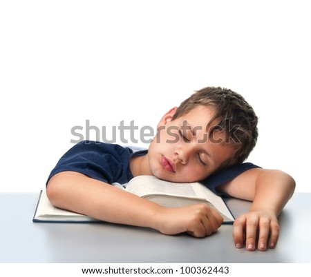isolated boy dreaming over thick book - stock photo